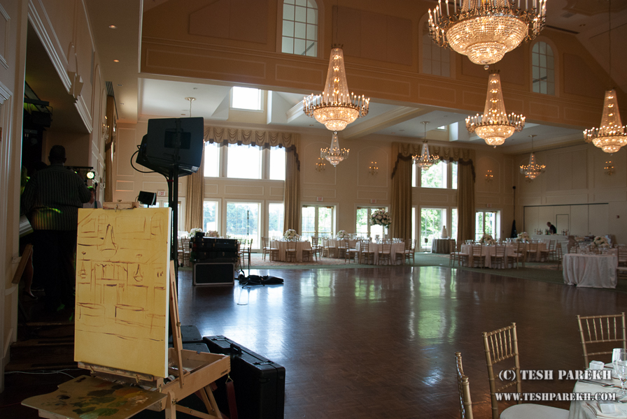 Live wedding painting in progress at the North Ridge Country Club